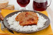 Stuffing Meat With Boiled Rice And Glass Of Red Wine