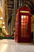 London Symbol Red Phone Box In Lightened Trade Passage