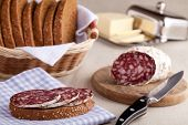 Served Kitchen Table, Sandwich On Napkin, Salami, Breadbasket, Sliced Bread