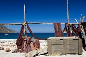 Picturesque Marine Landscape: Fishing Net And Chest On Sea Mountain Background