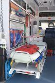 Ambulance Equipment Into The Emergency Vehicle