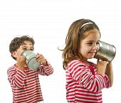 picture of toy phone  - boy and girl talking on a tin phone isolated on white - JPG