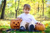 Smiling Little Boy With Two Halloween Pumpkins