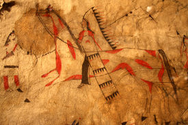 stock photo of tipi  - Scene from a Native American Indian Tipi showing a warrior and horse - JPG