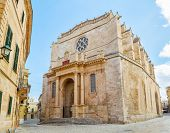Old Santa Maria Cathedral at Ciutadella, Menorca island, Spain. It was being built between 1300 and 1362. The main facade in neo-classic style was constructed in 1813.