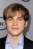 LOS ANGELES - JUL-24: Graham Patrick Martin kommt auf TNT 25th Anniversary Party bei der Beverly