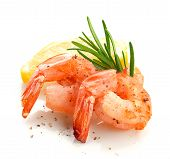 stock photo of crustacean  - Roasted tails of shrimps with fresh rosemary and lemon - JPG