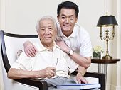 stock photo of korean  - portrait of an asian senior and his adult son - JPG