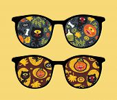 Retro sunglasses with halloween reflection in it.