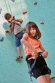Children With Climbing Equipment Against The Training Wall