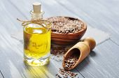 pic of flaxseeds  - Linseed oil and flax seeds on wooden background - JPG