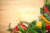 picture of edible  - healthy organic vegetables on a wood background - JPG
