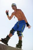 Young Man With Inline Skates In Summer Outdoor