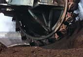 foto of collier  - Surface coal digging with large rotating blades excavators - JPG