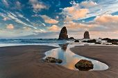 foto of haystacks  - Haystack Rock at sunset Cannon Beach Oregon - JPG