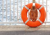 Life buoy or preserver on pier at mariner
