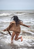 pic of seminude  - Beautiful young seminude woman in the cold sea waves - JPG