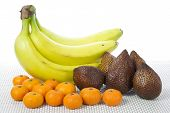 Fruits Bananas Salak and Clementines with white background