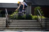 Skateboarder Doing A Kickflip Down Stairs