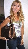 OXFORD - JULY 27: Julia Verdin wearing a top by Buffalo, Red Engine Jeans, handbag by Unisa, and Jew