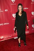 Gina Gershon at MusiCares Person Of The Year Honoring Bruce Springsteen, Los Angeles Convention Center, Los Angeles, CA 02-08-13