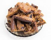 picture of baked raisin cookies  - Cookies with cherry and raisin on a round dish - JPG