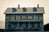 picture of abandoned house  - Century old abandoned opera house set against stormy gray skies  Fayette State H - JPG