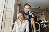Portrait of young couple in restaurant