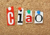 stock photo of goodbye  - The Italian word Ciao in cut out magazine letters pinned to a cork notice board - JPG
