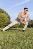 Full length of determined man exercising in park