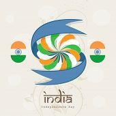 Stylish badge in Indian National Flag colors with blue ribbon on abstract brown background for 15th