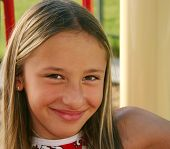 Kid Smiling On Playground