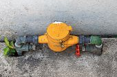 Old Water Valve With Yellow Water Meter