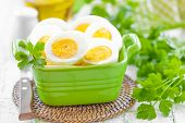 stock photo of boil  - Boiled eggs in a bowl on a table - JPG