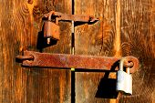 Old two rusty locks on wooden door