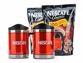 Ankara, Turkey - April 12, 2013: Nescafe instant coffee refill and promotional red Nescafe mug isola