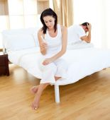 stock photo of pregnancy test  - Cheerless couple finding out results of a pregnancy test in the bedroom - JPG