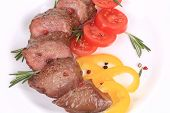 Beefsteaks with tomatoes and rosemary.