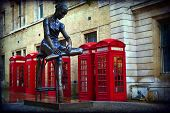 stock photo of covenant  - Traditional old style UK red phone boxes in London in Coven Garden - JPG