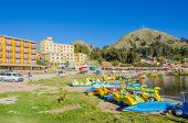 COPACABANA, BOLIVIA, MAY 6, 2014 - Pedal boats for hire in port of Copacabana at Titicaca lake shore