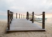 beach, sea, summer and leisure concept - close up of pier on tropical beach