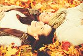 holidays, love, travel, tourism, relationship and dating concept - romantic couple in the autumn par