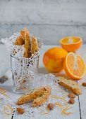 Orange biscotti with almonds in a glass