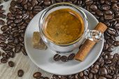 Fresh Espresso Coffee With Sugar, Cinnamon And Lot Of Beans