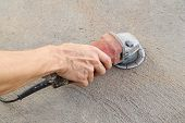 Hand With Grinding Tool