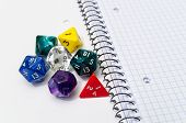 Role Playing Dices Lying On Exercise Book