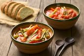 image of hungarian  - Two bowls of Hungarian traditional dish called Lecso a vegetarian stew made of onion pepper and tomato seasoned with salt and pepper - JPG