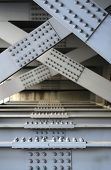 foto of girder  - The underside of a bridge with large steel girders bolts and nuts - JPG