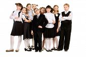 Group of cheerful schoolchildren standing together. Full length portrait. Isolated over white.