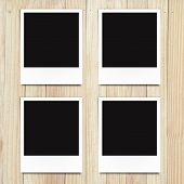 blank photo frames on wood background